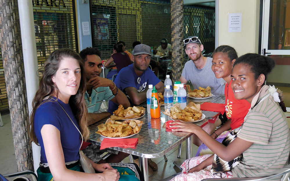 blank canvas solomon islands group sitting at table