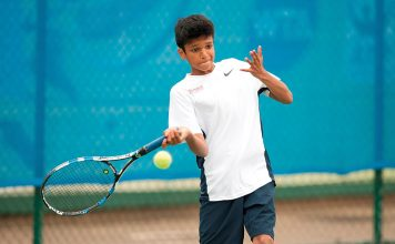 Esah Hayat playing tennis