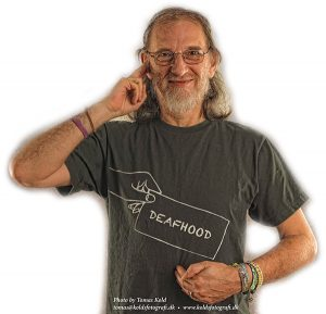 """Dr Paddy Ladd with """"Deaf"""" + """"Hood"""" sign language."""