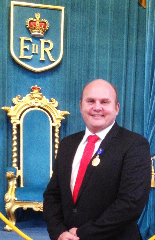 Dean Barton-Smith and his Order of Australia Medal award.