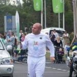 Dean Barton-Smith with Queen's Baton Relay for Commonwealth Games.