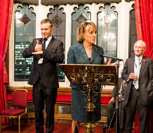 Dame Esther-Rantzen speaks on behalf of Exeter Deaf Academy at the House of Lords. Left: Tim Griffin - BSL Interpreter. Right: The Lord Speaker